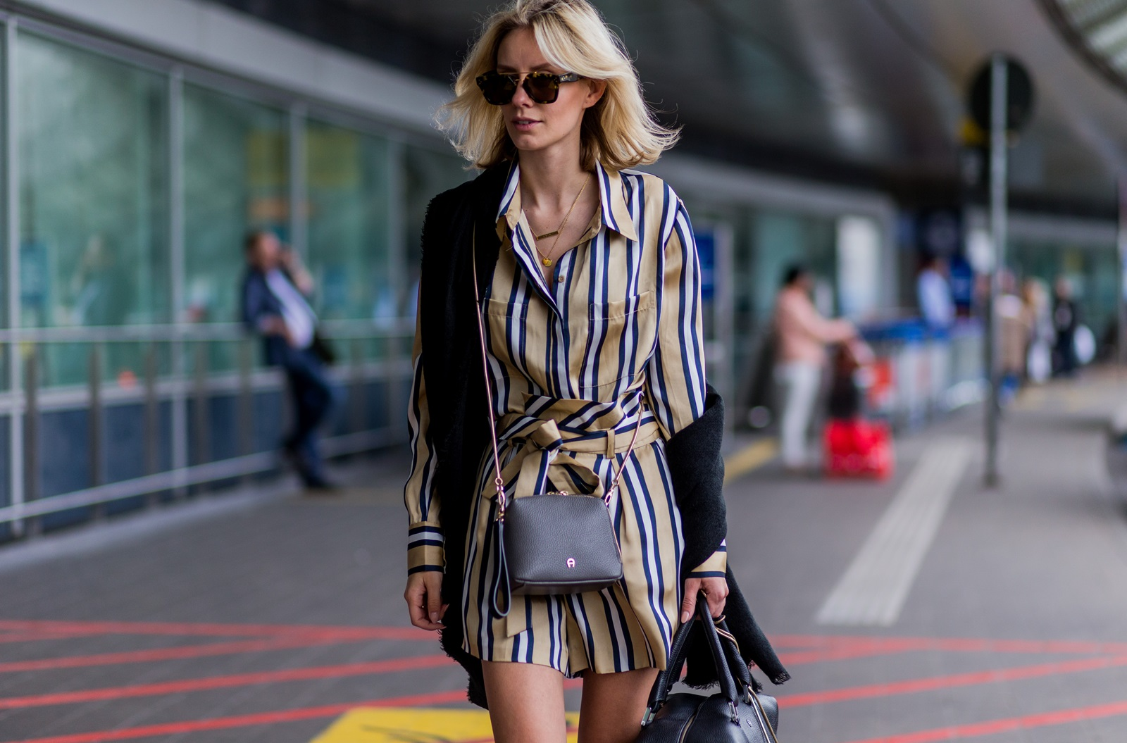 DUESSELDORF, GERMANY - JUNE 1: Lisa Hahnbueck at the airport wearing a striped blouse and shorts from Finders Keepers, black Celine sunglasses, a black scarf a black weekender bag from Aigner Munich and golden bag on June 1, 2016 in Duesseldorf, Germany. (Photo by Christian Vierig/Getty Images) *** Local Caption *** Lisa Hahnbueck