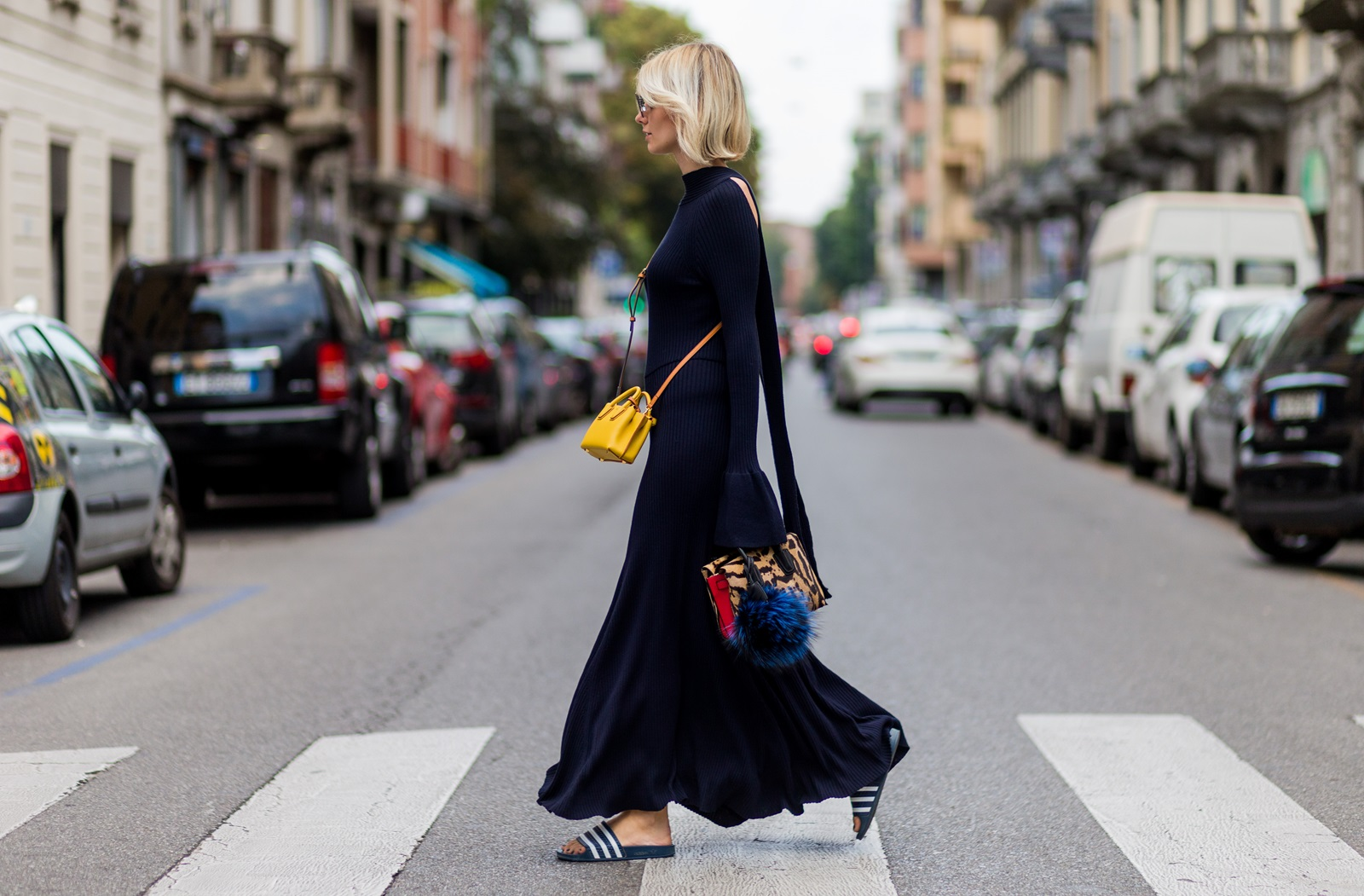 MILAN, ITALY - SEPTEMBER 21: Lisa Hahnbueck (@lisarvd) wearing a backless Knitdress with big sleeves H&M Trend, Milla Gepard Tote Mini + Milla Micro Bag / X-Mini, adiletten, Fendi sunglasses is seen outside Alberta Ferretti during Milan Fashion Week Spring/Summer 2017 on September 21, 2016 in Milan, Italy. (Photo by Christian Vierig/Getty Images) *** Local Caption *** Lisa Hahnbueck