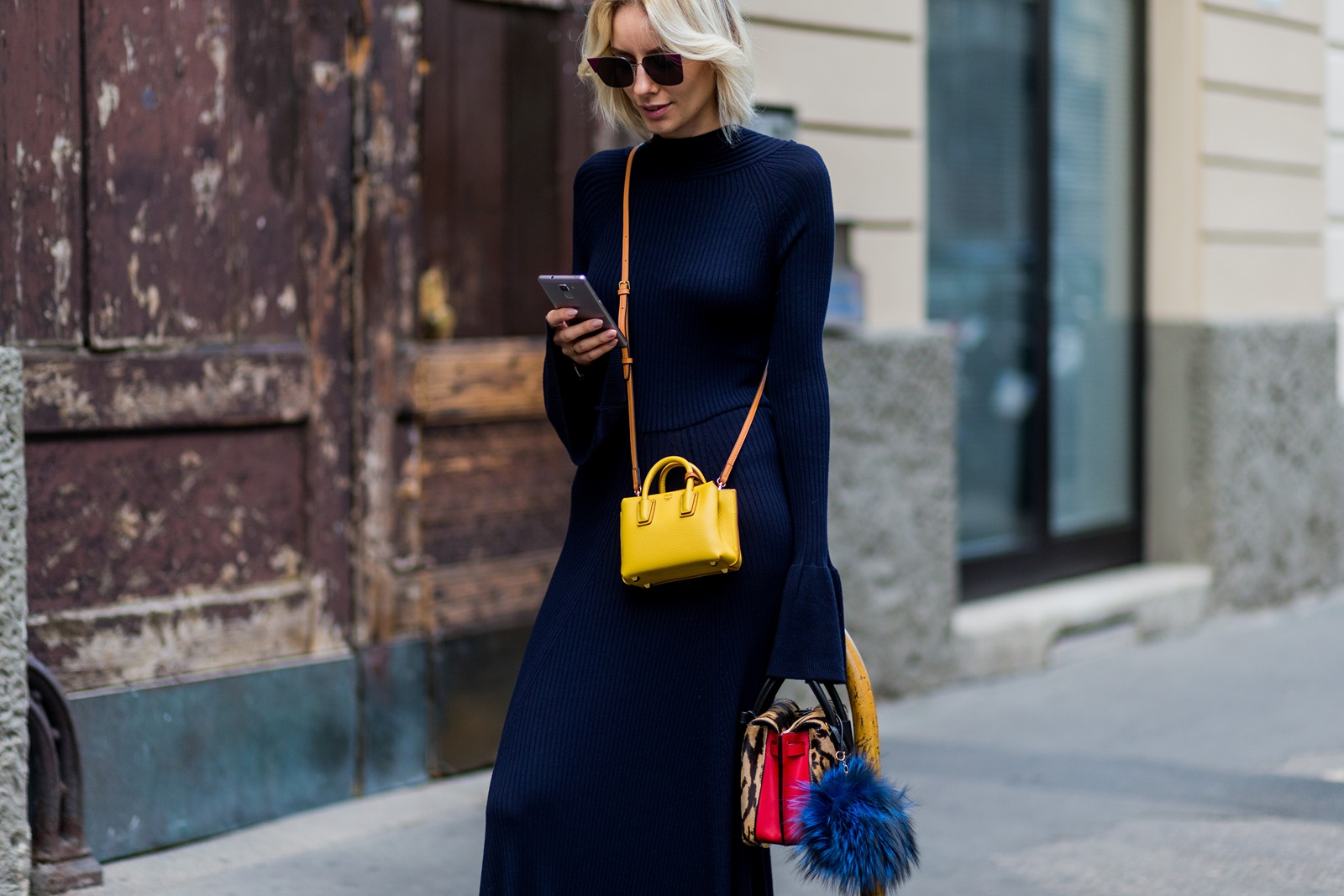 MILAN, ITALY - SEPTEMBER 21: Lisa Hahnbueck (@lisarvd) wearing a backless Knitdress with big sleeves H&M Trend, Milla Gepard Tote Mini + Milla Micro Bag / X-Mini, Fendi sunglasses is seen outside Alberta Ferretti during Milan Fashion Week Spring/Summer 2017 on September 21, 2016 in Milan, Italy. (Photo by Christian Vierig/Getty Images) *** Local Caption *** Lisa Hahnbueck