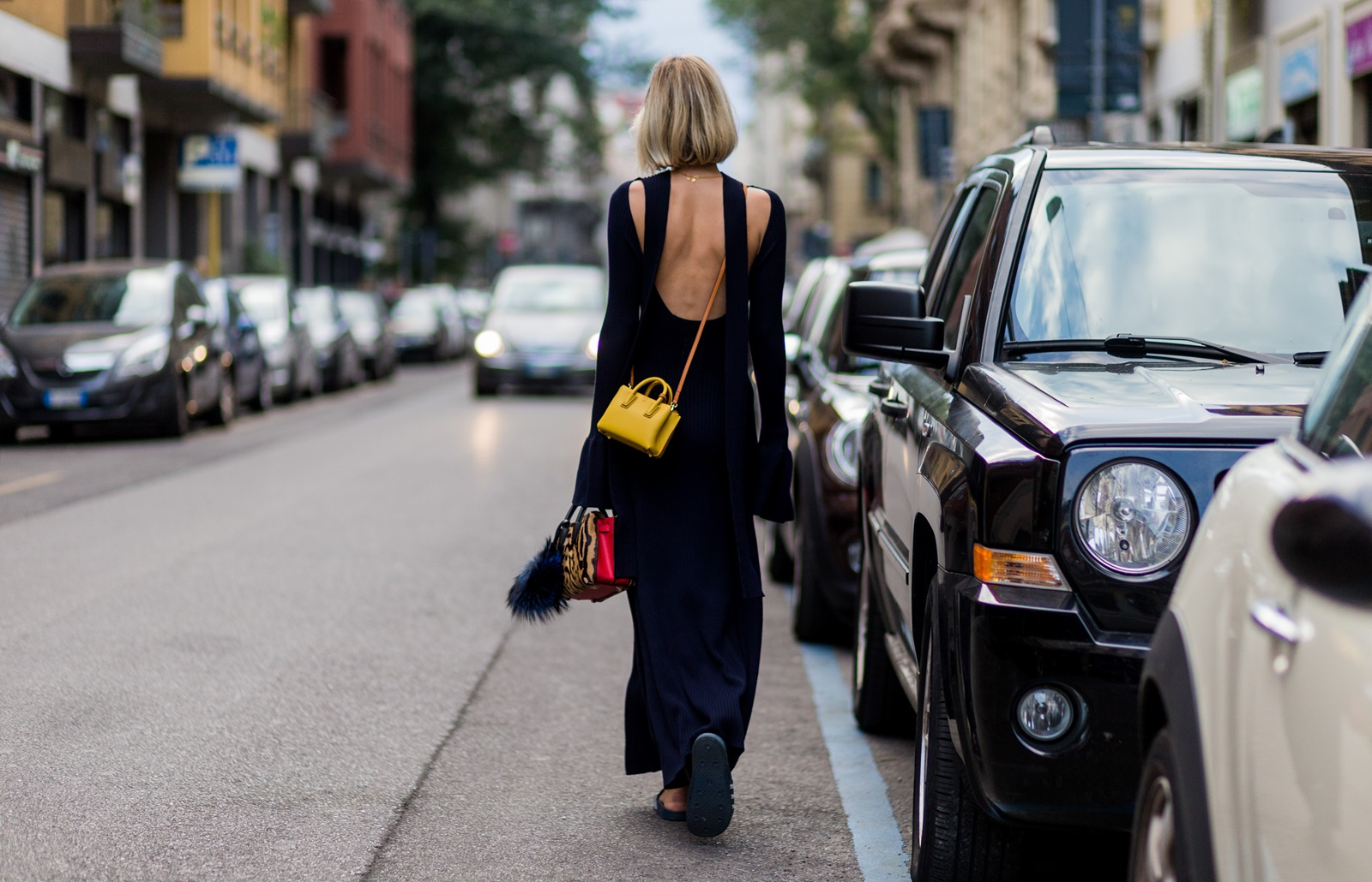 MILAN, ITALY - SEPTEMBER 21: Lisa Hahnbueck (@lisarvd) wearing a backless Knitdress with big sleeves H&M Trend, Milla Gepard Tote Mini + Milla Micro Bag / X-Mini, adiletten, is seen outside Alberta Ferretti during Milan Fashion Week Spring/Summer 2017 on September 21, 2016 in Milan, Italy. (Photo by Christian Vierig/Getty Images) *** Local Caption *** Lisa Hahnbueck
