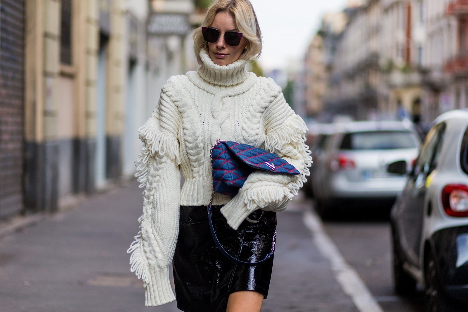 MILAN, ITALY - SEPTEMBER 21: Lisa Hahnbueck wearing a OffWhite Knit Turtle Neck, Oversized Sleeves & Fringes, Mango Asymmetric Patent Leather Skirt with Belt, Louis Vuitton GO-14 PM Denim Bag, Fendi sunglasses is seen outside Alberta Ferretti during Milan Fashion Week Spring/Summer 2017 on September 21, 2016 in Milan, Italy. (Photo by Christian Vierig/Getty Images) *** Local Caption *** Lisa Hahnbueck