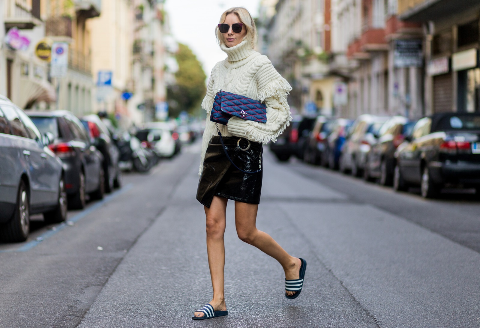 MILAN, ITALY - SEPTEMBER 21: Lisa Hahnbueck wearing a OffWhite Knit Turtle Neck, Oversized Sleeves & Fringes, Mango Asymmetric Patent Leather Skirt with Belt, Adiletten, Louis Vuitton GO-14 PM Denim Bag, Fendi sunglasses is seen outside Alberta Ferretti during Milan Fashion Week Spring/Summer 2017 on September 21, 2016 in Milan, Italy. (Photo by Christian Vierig/Getty Images) *** Local Caption *** Lisa Hahnbueck