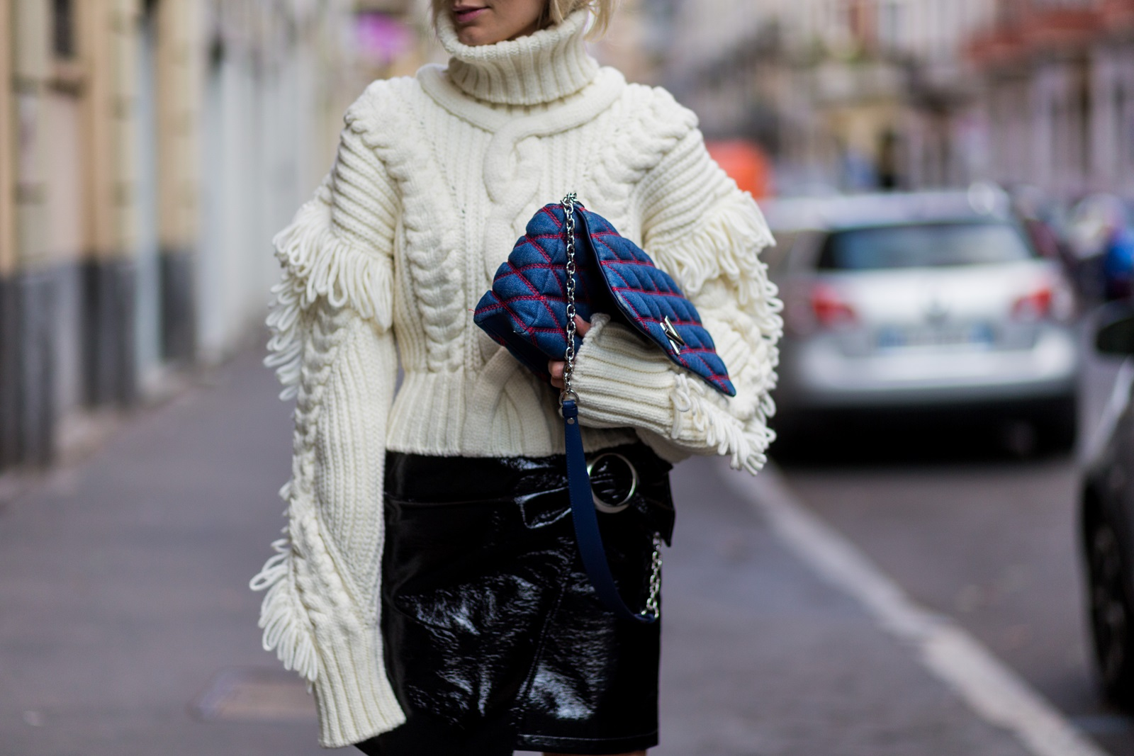 MILAN, ITALY - SEPTEMBER 21: Lisa Hahnbueck wearing a OffWhite Knit Turtle Neck, Oversized Sleeves & Fringes, Mango Asymmetric Patent Leather Skirt with Belt, Louis Vuitton GO-14 PM Denim Bag, is seen outside Alberta Ferretti during Milan Fashion Week Spring/Summer 2017 on September 21, 2016 in Milan, Italy. (Photo by Christian Vierig/Getty Images) *** Local Caption *** Lisa Hahnbueck