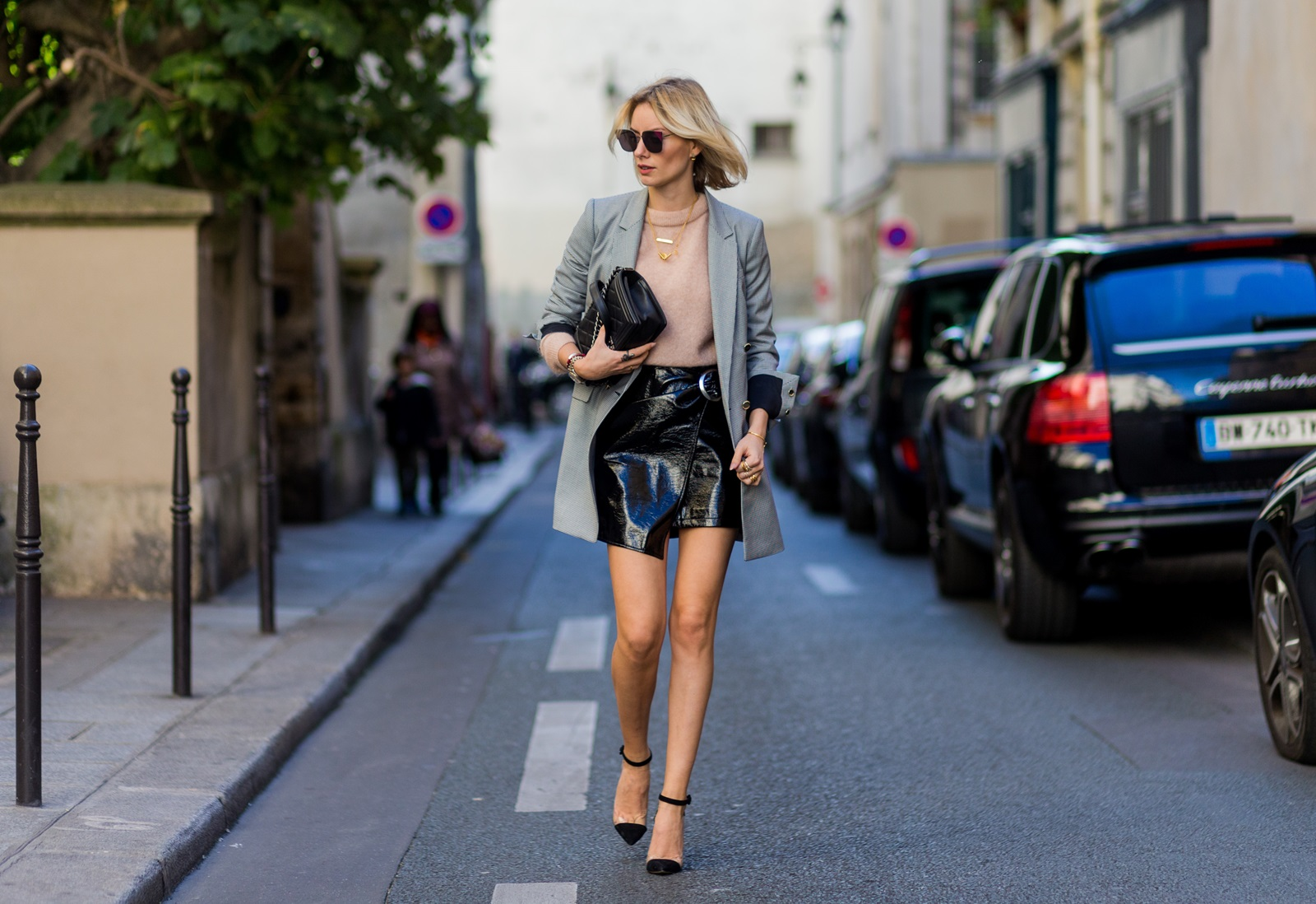 PARIS, FRANCE - OCTOBER 03: German fashion blogger Lisa Hahnbueck (@lisarvd) wearing Blazer: Guess, Knit: Acne Studios Skirt: Patent Asymmetric Leather Skirt Mango, Heels: Plexi Heels Gianvito Rossi, bag: Chanel Boy Bag, Sunglasses: Fendi outside Hermes on October 3, 2016 in Paris, France. (Photo by Christian Vierig/Getty Images) *** Local Caption *** Lisa Hahnbueck