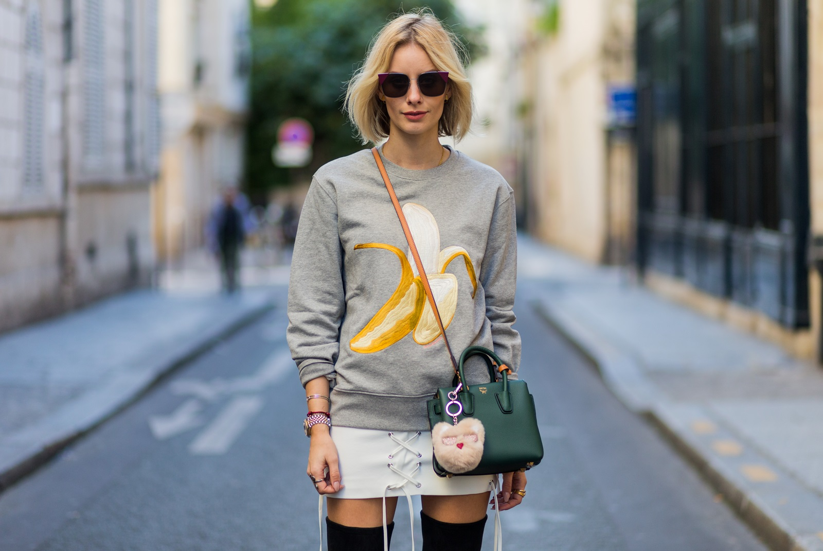PARIS, FRANCE - OCTOBER 03: German fashion blogger Lisa Hahnbueck (@lisarvd) wearing Carly Banana Sweatshirt Acne Studios, Isla Skirt, Boots: Overknee Boots Alllegs Stuart Weitzman, Sunglasses : Fendi Bag: MCM Milla Mini outside Hermes on October 3, 2016 in Paris, France. (Photo by Christian Vierig/Getty Images) *** Local Caption *** Lisa Hahnbueck