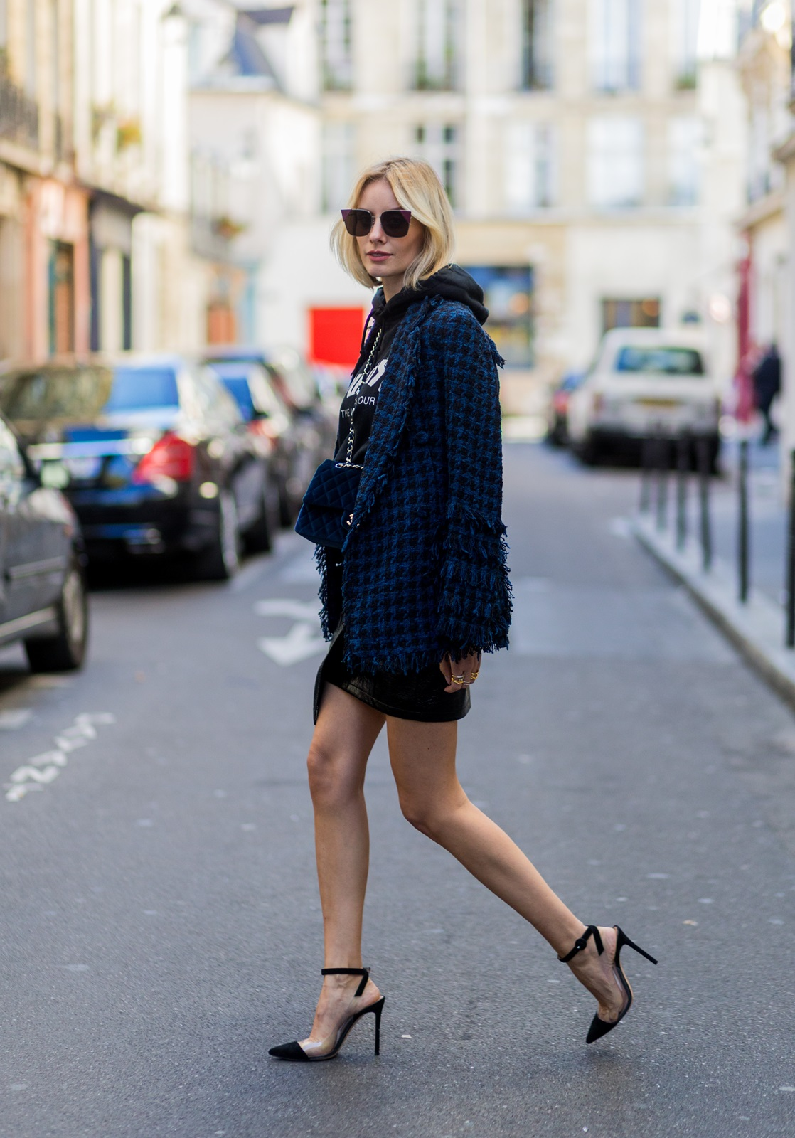 PARIS, FRANCE - OCTOBER 03: German fashion blogger Lisa Hahnbueck (@lisarvd) wearing blazer: Tweed Blazer MSGM hoodie: Justin Bieber Purpose Tour Merchandise Sweatshirt Skirt: Patent Asymmetric Leather Skirt Mango, Heels: Plexi Heels Gianvito Rossi, Bag: Chanel Velvet Classic Flap Bag, sunglasses: Fendi outside Hermes on October 3, 2016 in Paris, France. (Photo by Christian Vierig/Getty Images) *** Local Caption *** Lisa Hahnbueck