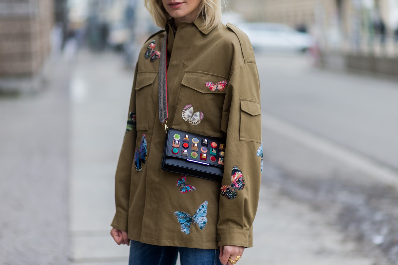 BERLIN, GERMANY - JANUARY 19: Lisa Hahnbueck wearing Valentino Butterfly Printed Cotton Jacket, Closed Jeans, Zara Colored Over Knee Boots, Fendi Clutch Bag with colored studs, MCM Phyton Strap during the Mercedes-Benz Fashion Week Berlin A/W 2017 at Kaufhaus Jandorf on January 19, 2017 in Berlin, Germany. (Photo by Christian Vierig/Getty Images) *** Local Caption *** Lisa Hahnbueck