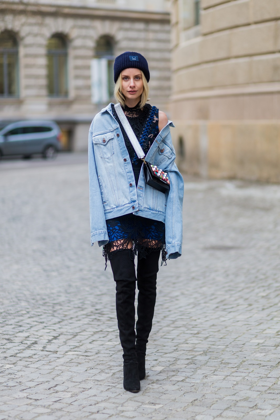 BERLIN, GERMANY - JANUARY 19: Lisa Hahnbueck wearing Off White Printed Denim Jacket Men Section, Self-Portrait Embroidered Dress with Lacing, Over knee Boots Stuart Weitzman Style Alllegs, Acne Studios Beanie, Fendi Clutch with colored Studs with MCM Phython strap during the Mercedes-Benz Fashion Week Berlin A/W 2017 at Kaufhaus Jandorf on January 19, 2017 in Berlin, Germany. (Photo by Christian Vierig/Getty Images) *** Local Caption *** Lisa Hahnbueck