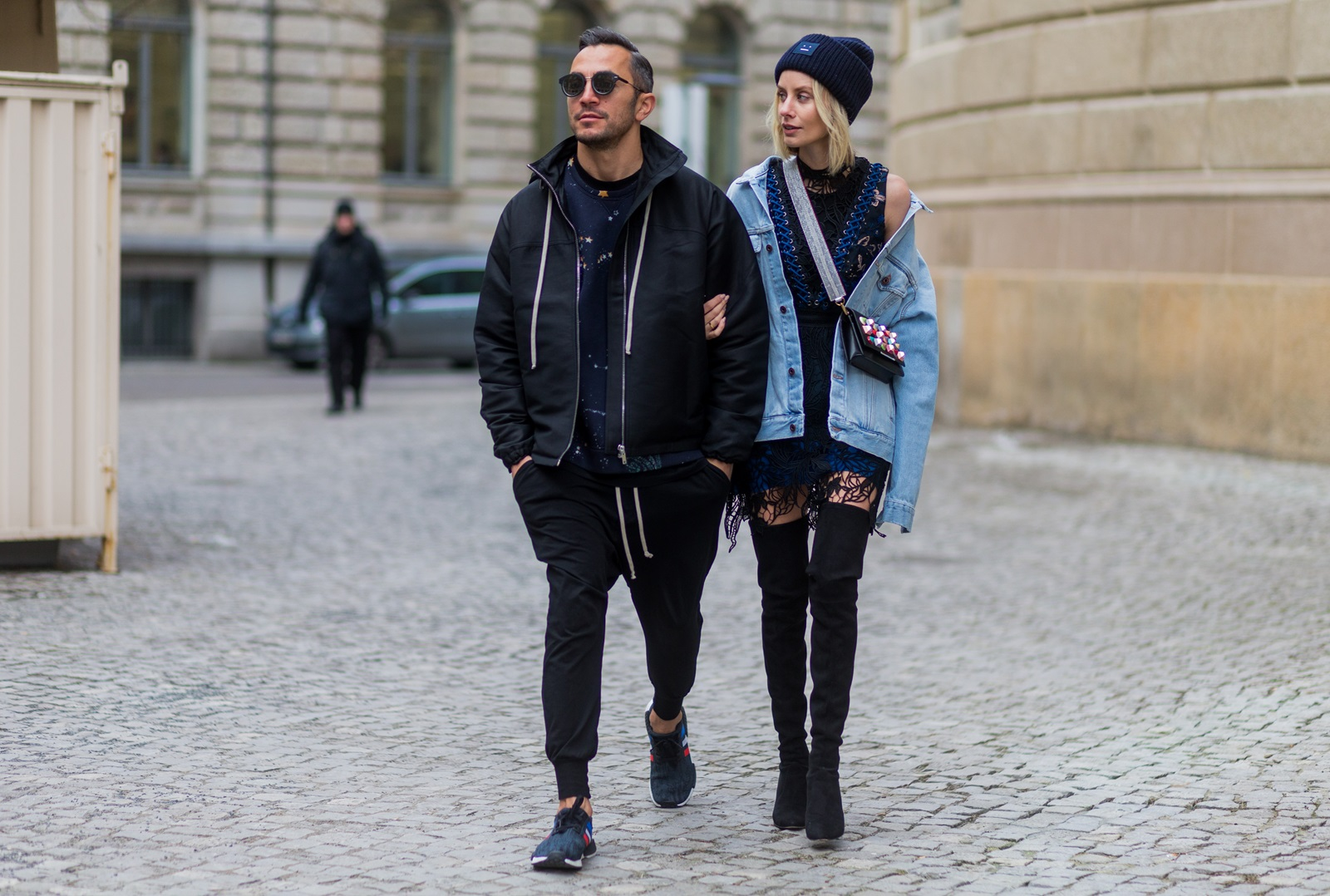 BERLIN, GERMANY - JANUARY 19: Couple Lisa Hahnbueck wearing Off White Printed Denim Jacket Men Section, Self-Portrait Embroidered Dress with Lacing, Over knee Boots Stuart Weitzman Style Alllegs, Acne Studios Beanie, Fendi Clutch with colored Studs with MCM Phython strap and Dima: RICK OWENS Zipped Jacket, Valentino Cosmo Printed sweatshirt, Rick Owens Cotton harem pants, Adidas NMD R1 sneaker, Dior Magnitude Sunglasses during the Mercedes-Benz Fashion Week Berlin A/W 2017 at Kaufhaus Jandorf on January 19, 2017 in Berlin, Germany. (Photo by Christian Vierig/Getty Images) *** Local Caption *** Lisa Hahnbueck; Dima