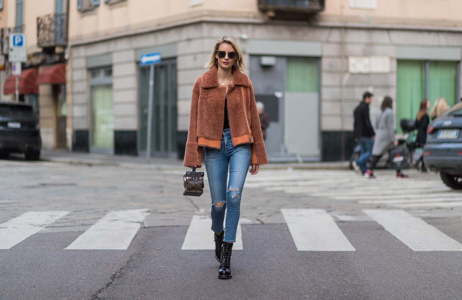 MILAN, ITALY - FEBRUARY 26: Lisa Hahnbueck wearing Designers Remix CANDY COAT BOXY SHEARLING COAT WITH LARGE COLLAR AND ZIPPER, CITIZENS OF HUMANITY JEANS, Louis Vuitton STAR TRAIL ANKLE BOOT, Louis Vuitton SUPPLE RIGID BAG IN MONOGRAM CANVAS, Prada Sunglasses during Milan Fashion Week Fall/Winter 2017/18 on February 26, 2017 in Milan, Italy. (Photo by Christian Vierig/Getty Images) *** Local Caption *** Lisa Hahnbueck