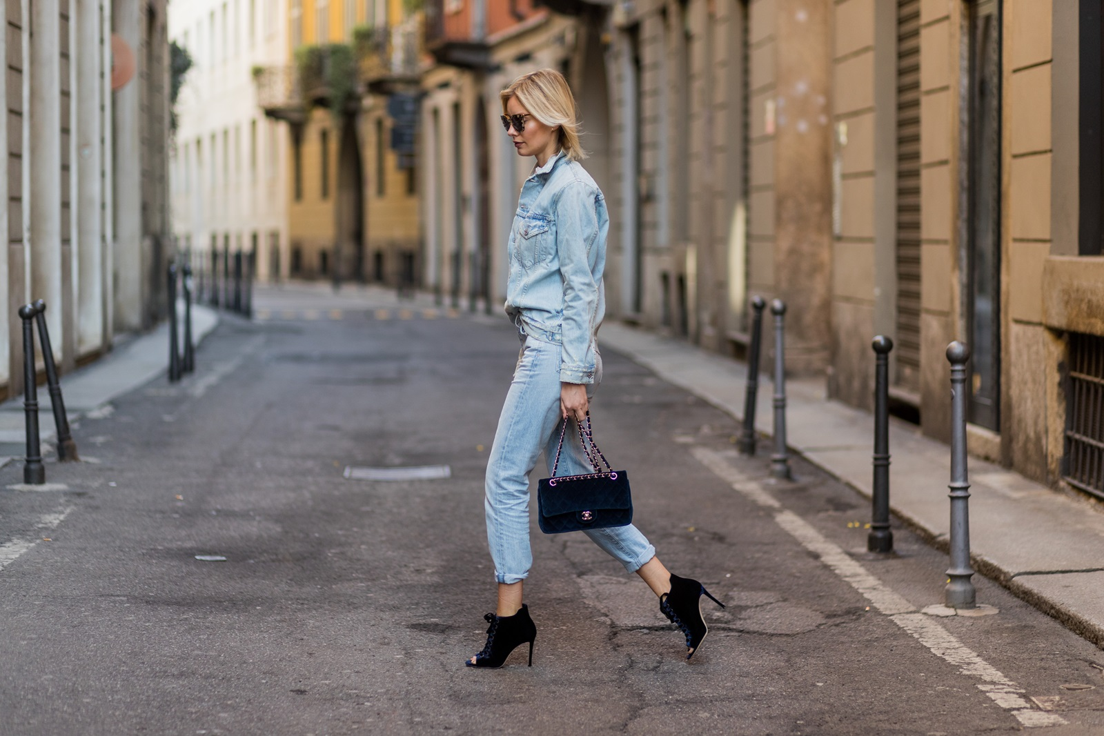 MILAN, ITALY - FEBRUARY 26: Lisa Hahnbueck wearing CITIZENS OF HUMANITY DENIM BOYFRIEND JACKET JASPER, CITIZENS OF HUMANITY LIYA HIGH RISE Jeans, GIAMBATTISTA VALLI SILK TOP WITH LACE, JIMMY CHOO MAVI VELVET BOOTS, CHANEL VELVET CLASSIC FLAP BAG, Prada Sunglasses during Milan Fashion Week Fall/Winter 2017/18 on February 26, 2017 in Milan, Italy. (Photo by Christian Vierig/Getty Images) *** Local Caption *** Lisa Hahnbueck