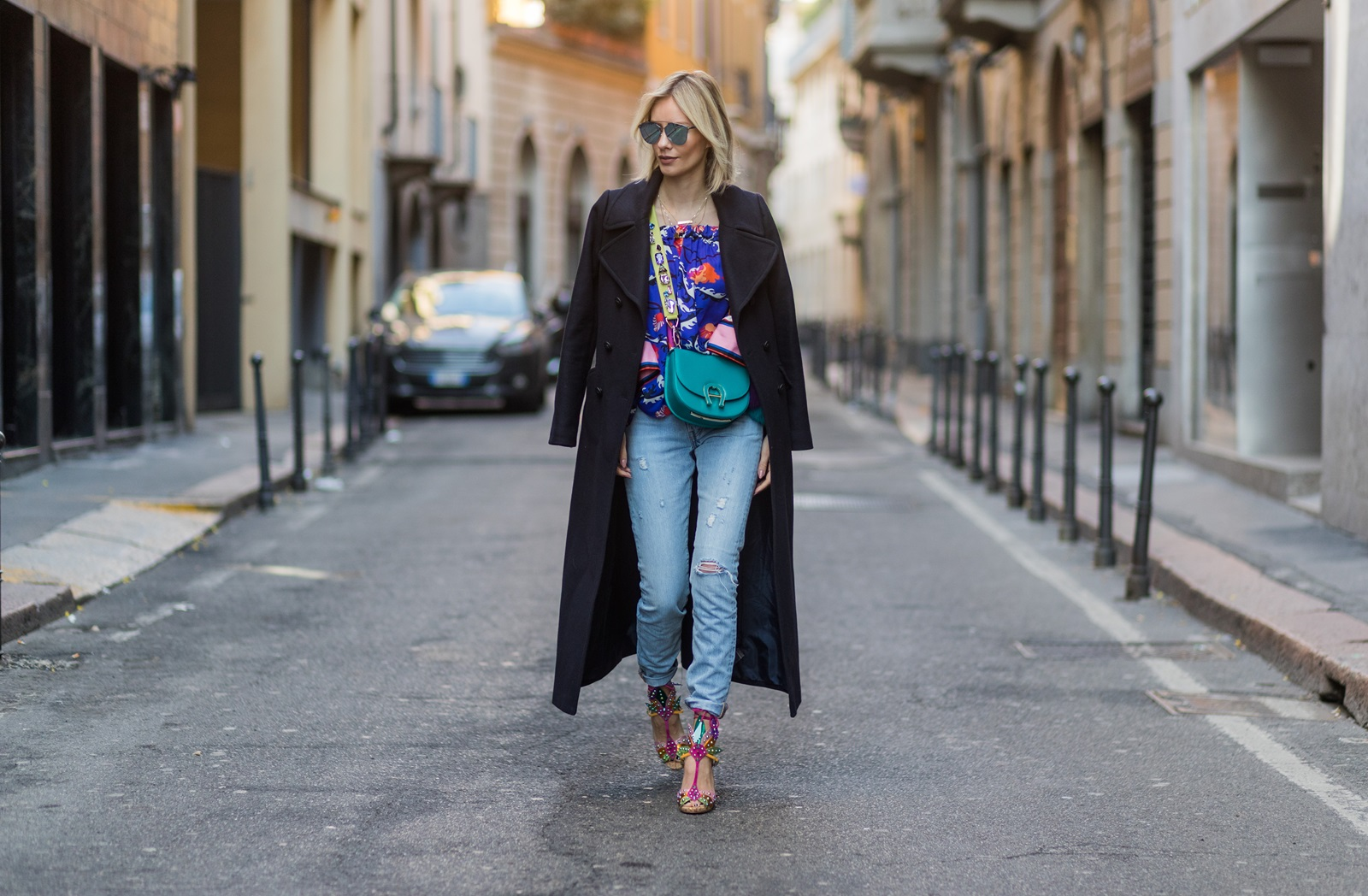 MILAN, ITALY - FEBRUARY 26: Lisa Hahnbueck wearing Hallhuber Maxi Coat, EMILIO PUCCI PRINTED SILK BLOUSE, LEVI´S 501 SKINNY, AIGNER PINA BAG WITH AIGNER STRAP WITH RHINESTONES, CHRISTIAN LOUBOUTIN Venenana Multi, Prada Sunglasses during Milan Fashion Week Fall/Winter 2017/18 on February 26, 2017 in Milan, Italy. (Photo by Christian Vierig/Getty Images) *** Local Caption *** Lisa Hahnbueck